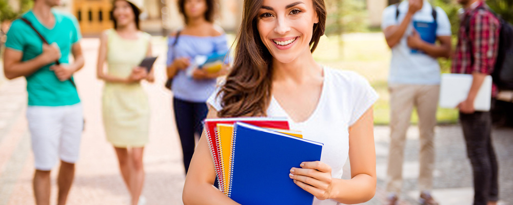 Happy student holding notebook