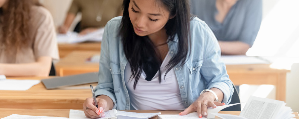 Asian girl study in library